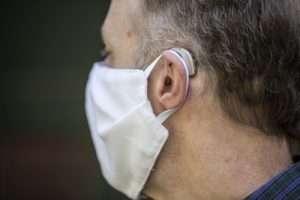 Face masks, hearing loss and hearing aids